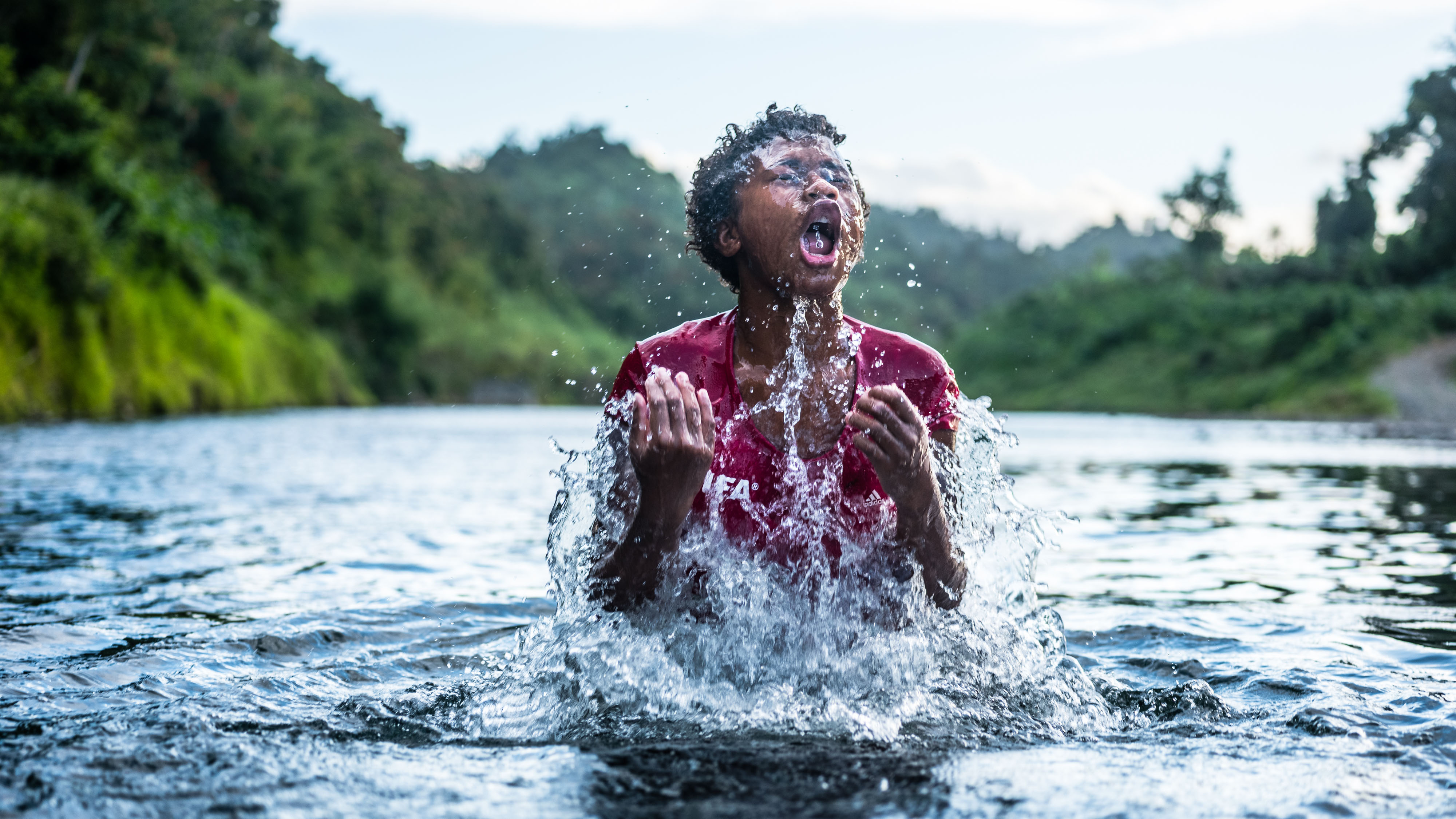 Ninia, 13, plays in the river near the Bucalevu village.